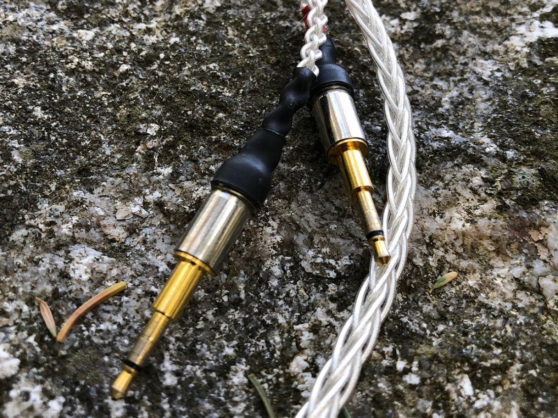 My DIY silver wire cables with gold 2.5mm headphone connectors.