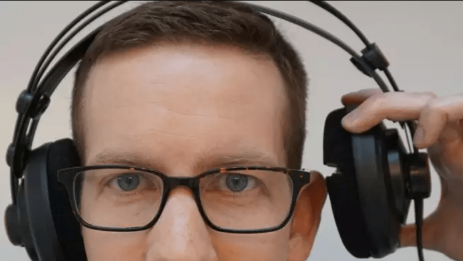 wearing glasses with headphones