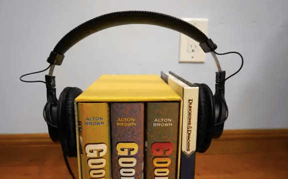 Stretching the headphones over a DIY stretching rack made from books