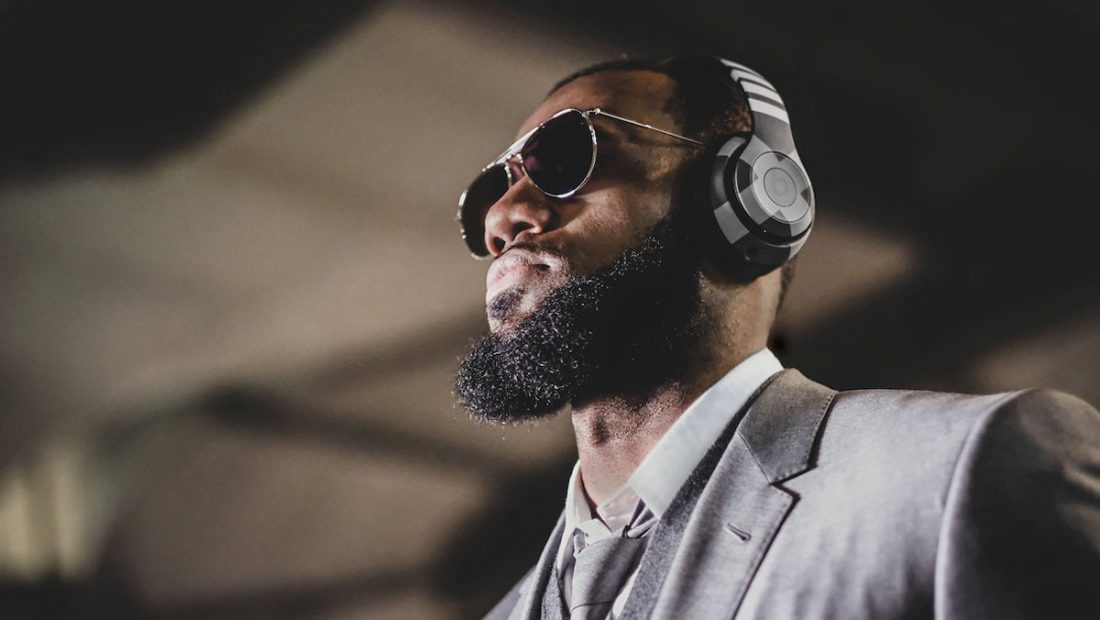 The King wearing the custom Thom Browne Studio3 x Beats by Dre Wireless Headphones