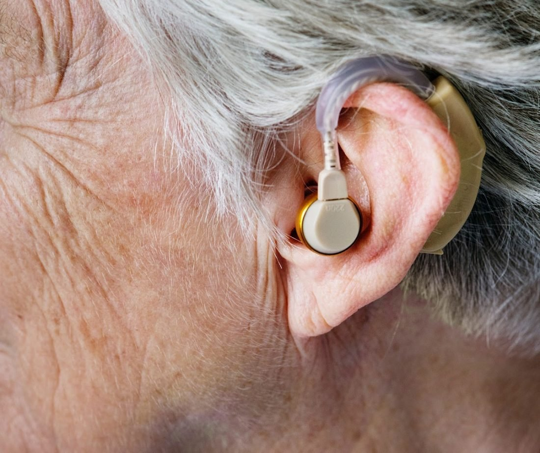 Old man with hearing aird