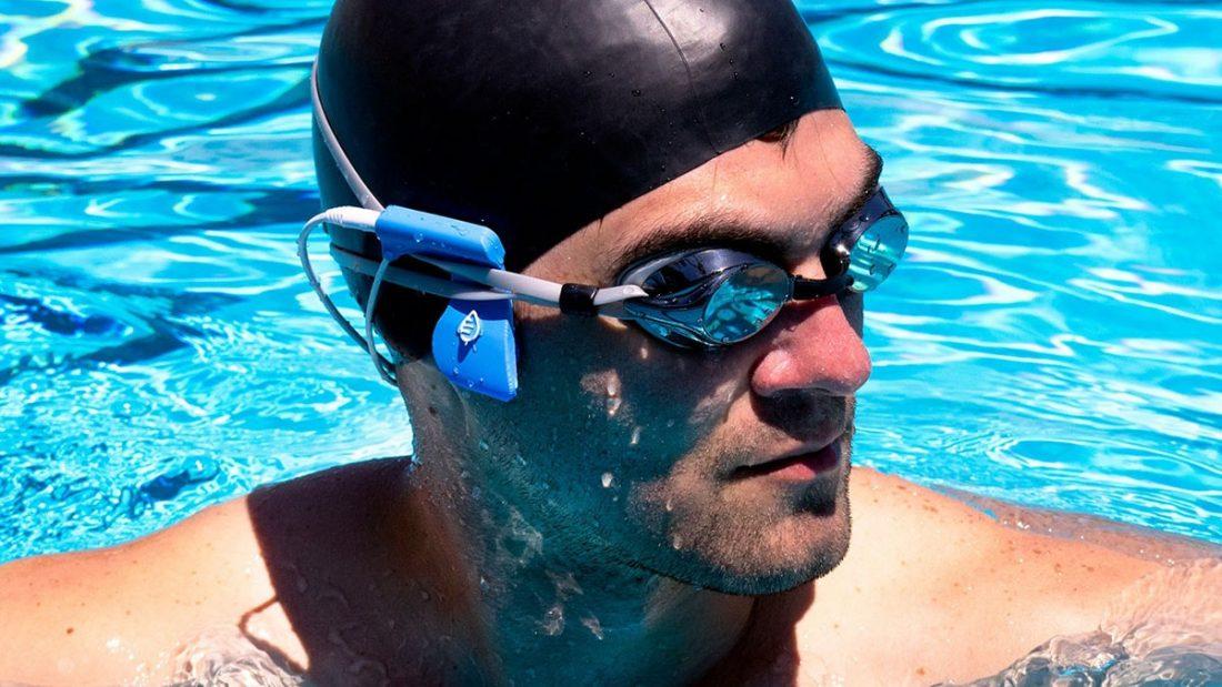 Swimmer with bone conduction headphones