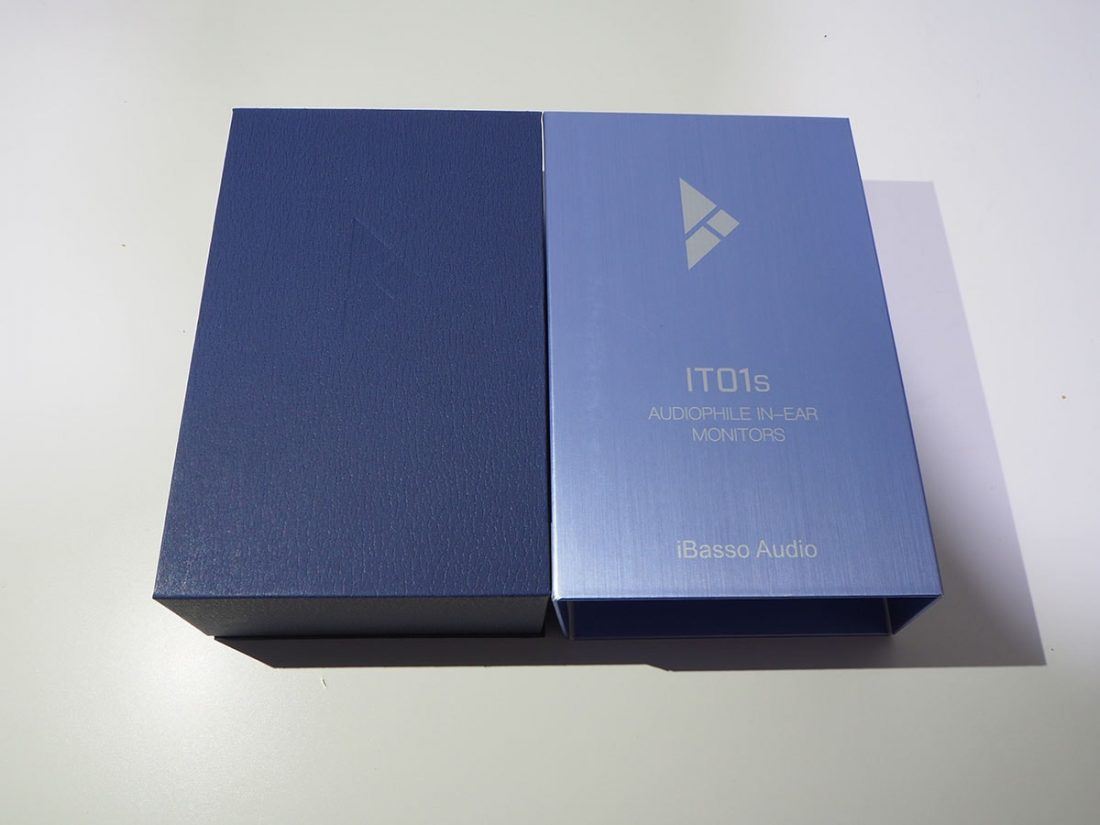 Darker blue hard box with an engraved iBasso logo