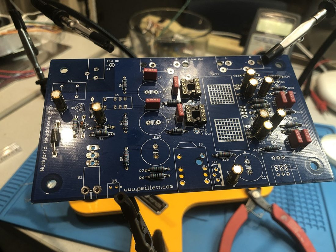Small capacitors, diodes, and OpAmp sockets are added to the board.