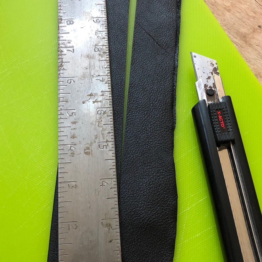 Excess material cut from the strap using a sharp blade.