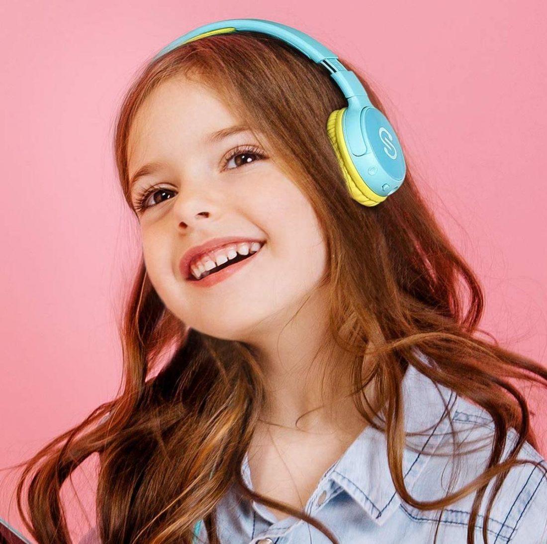 Kid wearing SoundPEATS headphones