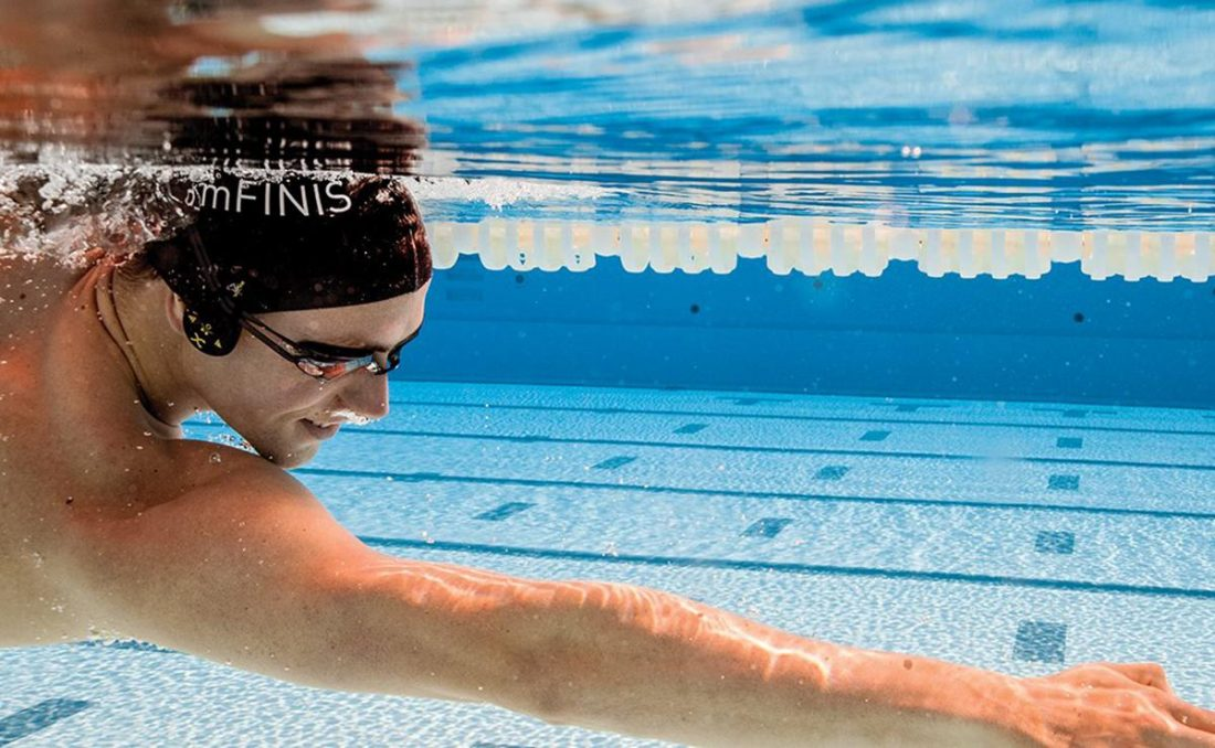 Swimmer wearing FINIS Duo