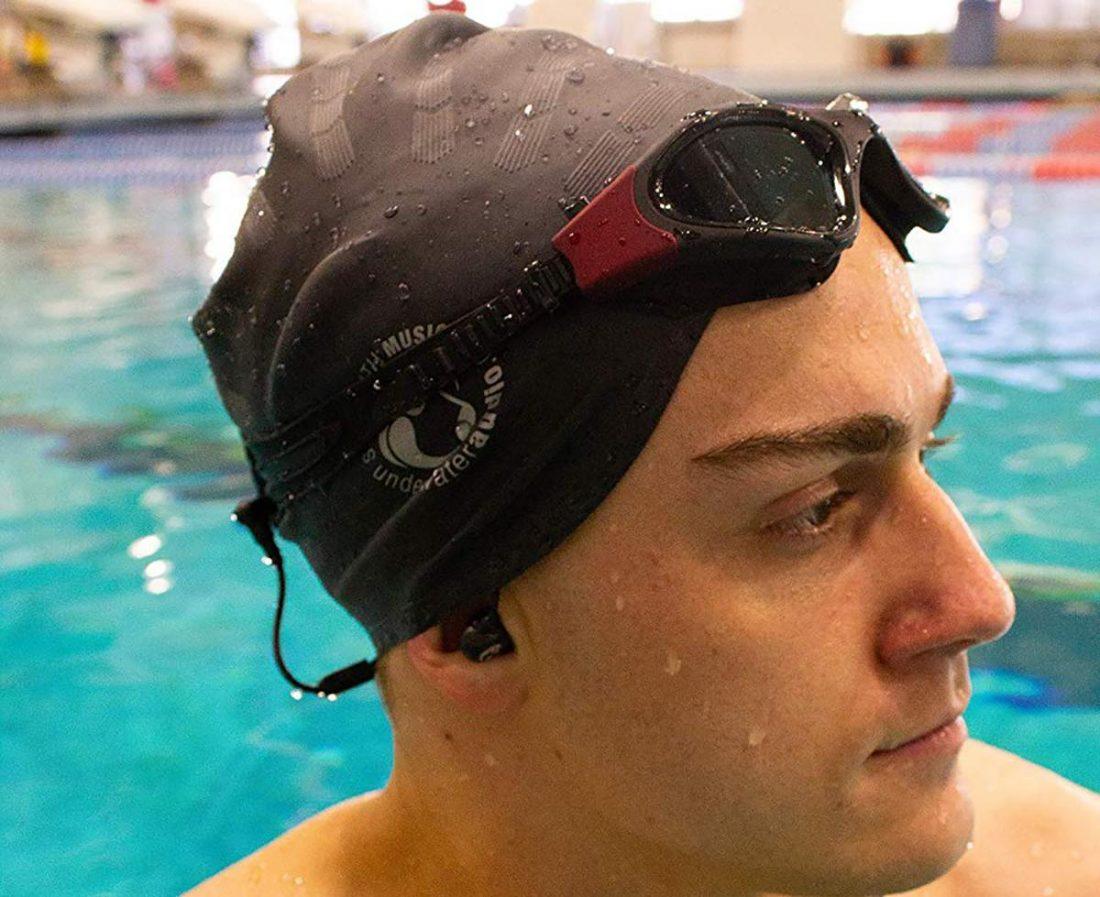Swimmer wearing the Swimbuds Flip