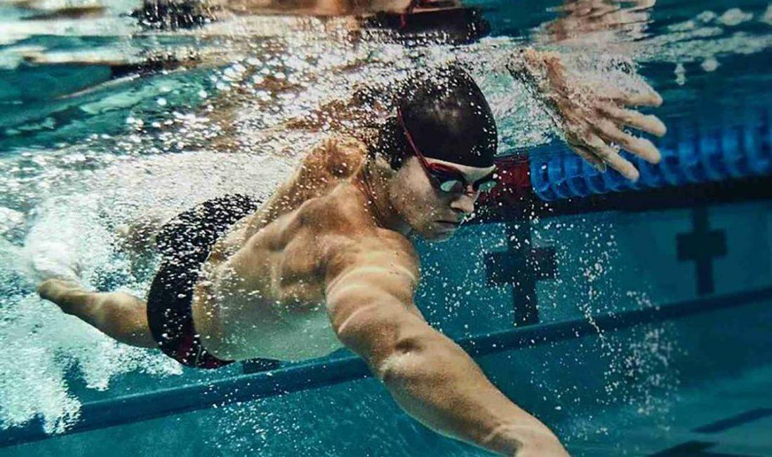Swimmer wearing waterproof headphones
