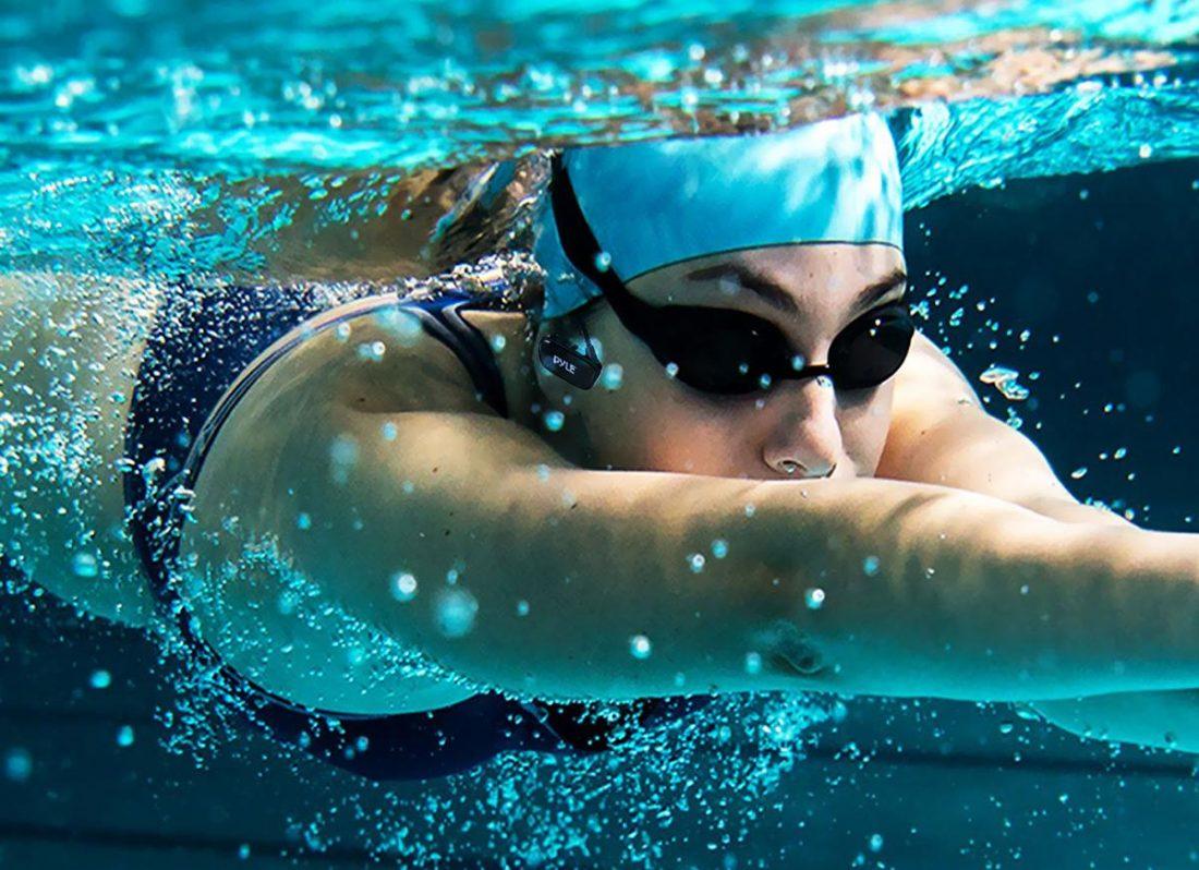 Swimmer wearing Pyle MP3 Headphones