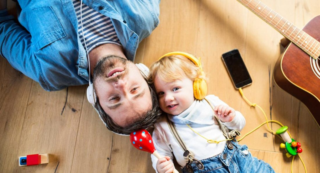 A dad and his toddler using headphones (from babycentre.co.uk)