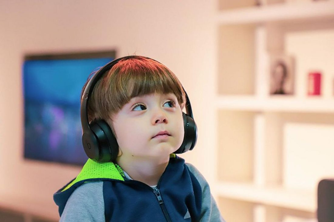 Little boy using headphones (from popsci.com)