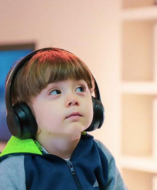 Little boy using headphones (from popsci.com)