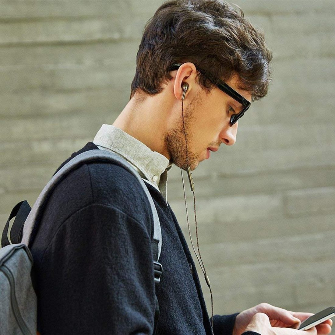 Man using 1More Quad Driver earphones (From: Amazon)