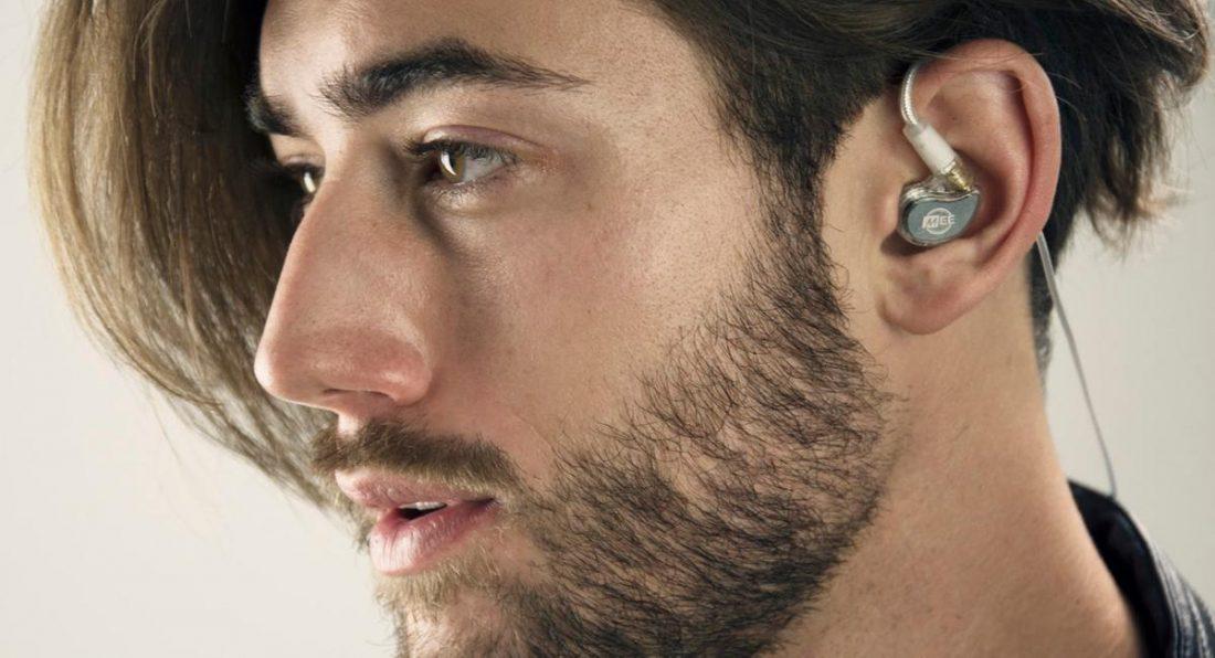 Man using M6 Pro 2nd Gen. Earphones (From: Mee Audio)