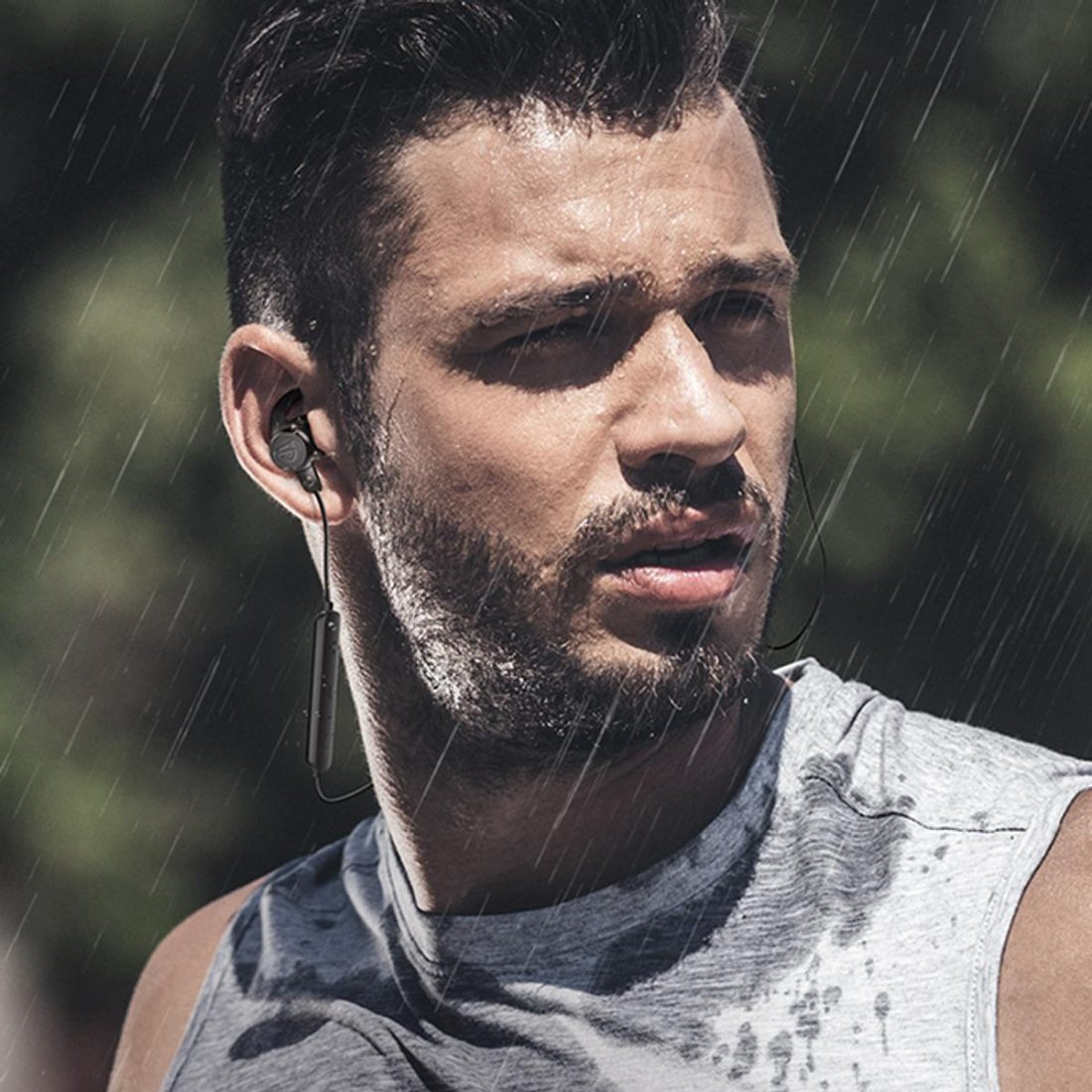 Man wearing SOUNDPEATS Q35 HD Wireless Earbuds in the rain (From: SOUNDPEATS)