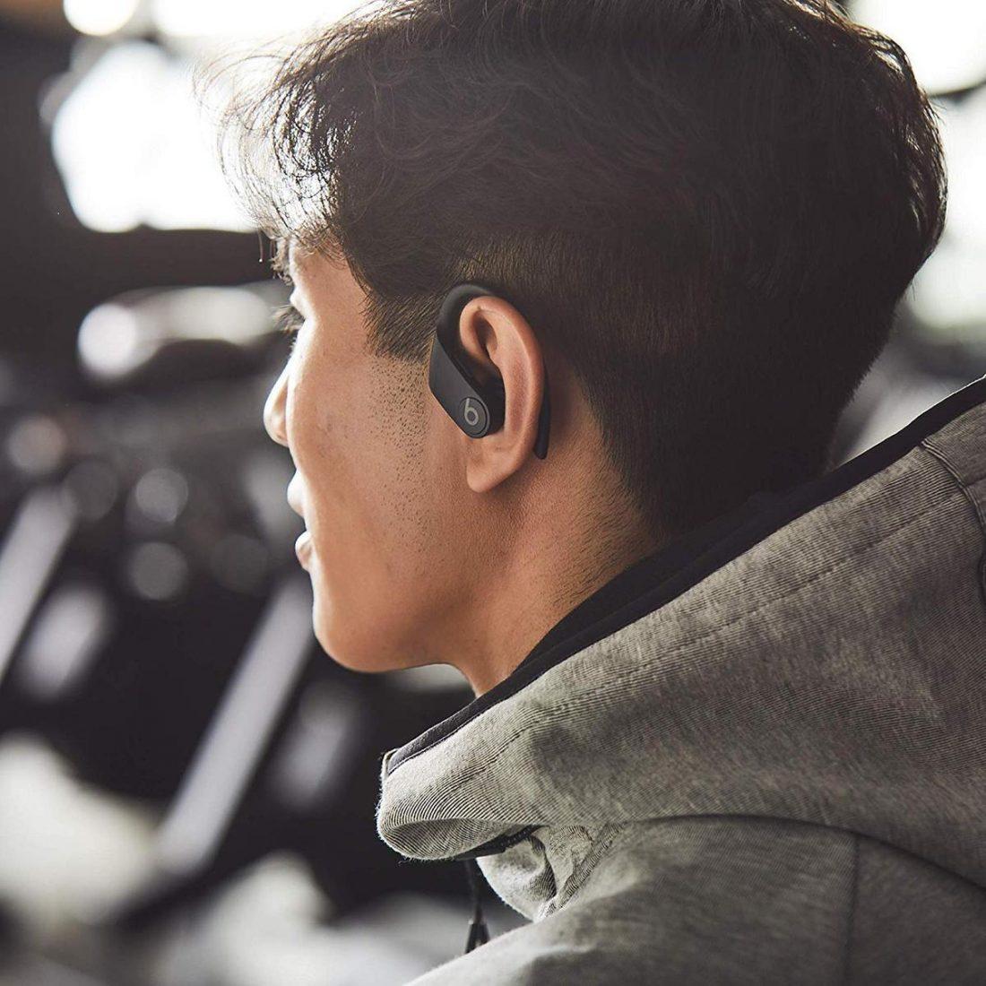 Man wearing Powerbeats Pro (From: Amazon)