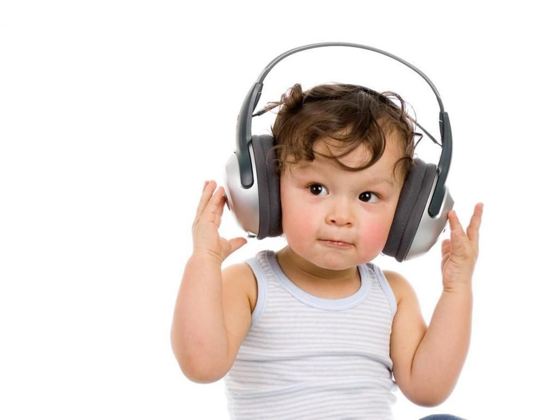 Toddler using grey headphones (From pinterest.com)