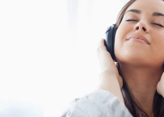 A girl with wireless headphones on. Canalys forecasts mart personal audio devices to be the fastest-growing category of smart devices. (From The Hearing Review)