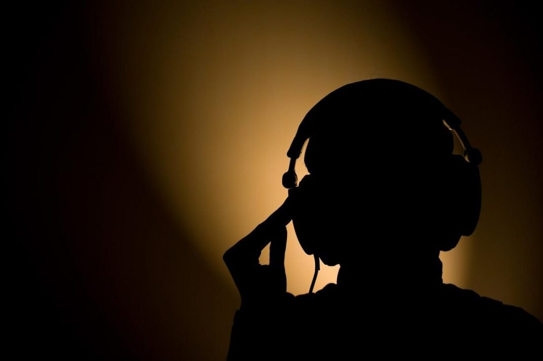 Silhouet of a person with headphones on (From: flickr.com)