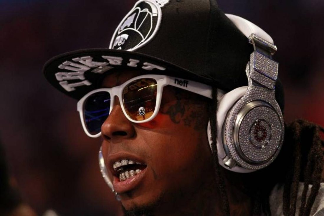 Lil Wayne wearing the Diamond And Ruby Beats Pro Headphones at a basketball game. (From Bleach Report)