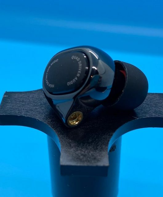 Detailed photo of the MiQuad Earbud detailing finish, MMCX jack, and eartip.